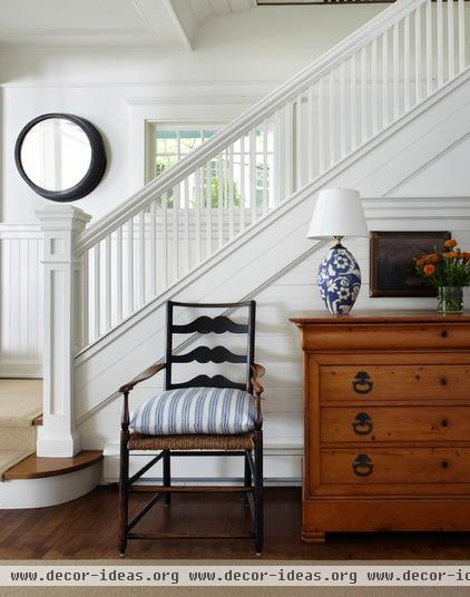 traditional staircase by Tom Stringer Design Partners