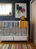 Contemporary Nursery With Blue-Gray Walls, Crib & Stuffed Yellow Lion Doll : Designers' Portfolio