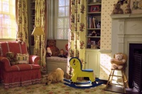 Cozy Nursery with Red Chair and Floral Carpert and Drapes in Yellow, Red and Green : Designers' Portfolio