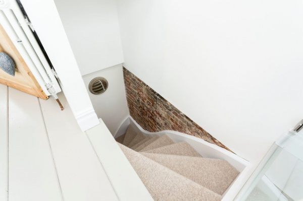 Contemporary Staircase by Westcott Construction Ltd