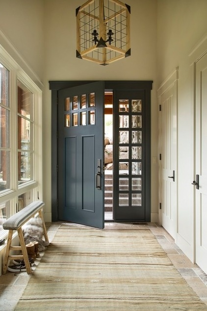 Rustic Entry by Massucco Warner Miller Interior Design