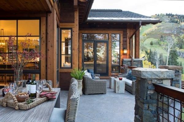 Rustic Exterior by Massucco Warner Miller Interior Design